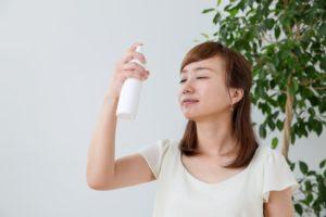 Woman applying facial mist