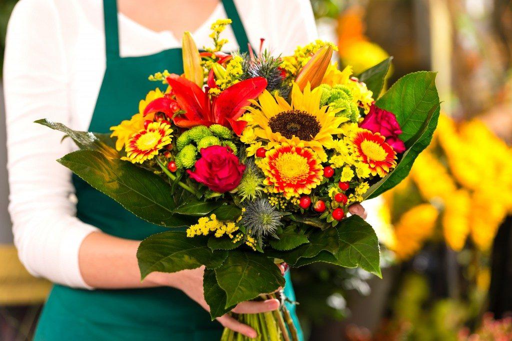 Vendor holding flowers