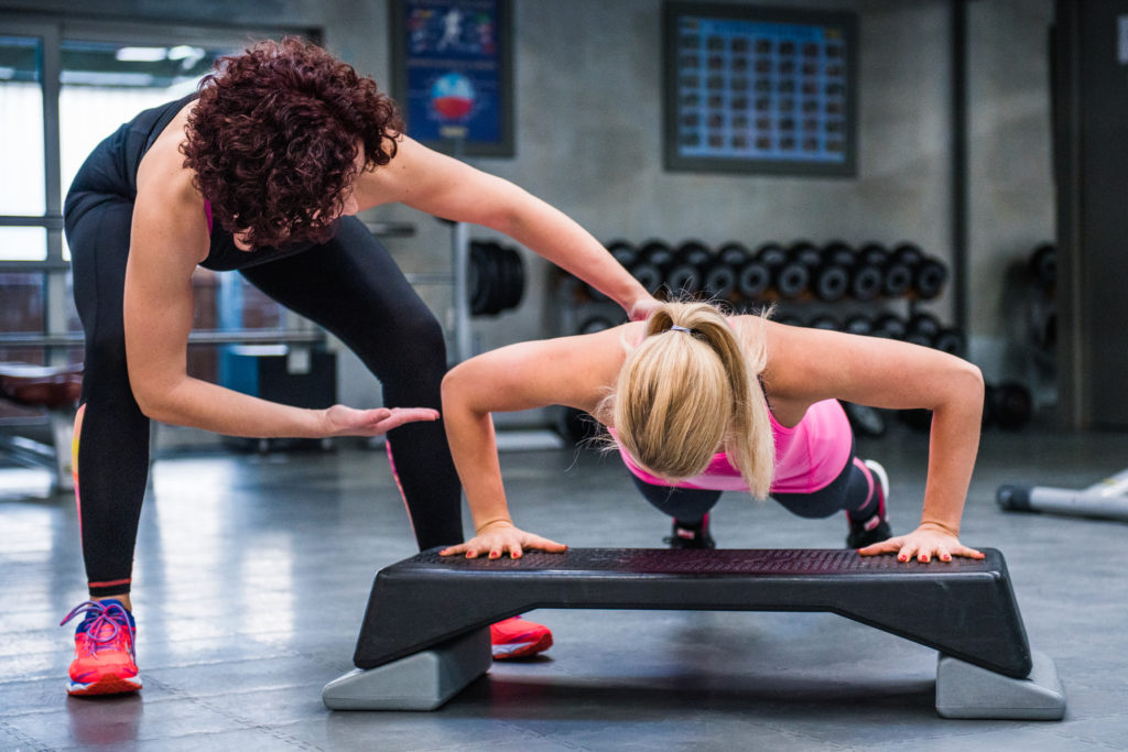 Fitness instructor teaching a woman