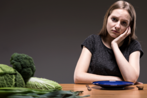Woman suffering from an eating disorder