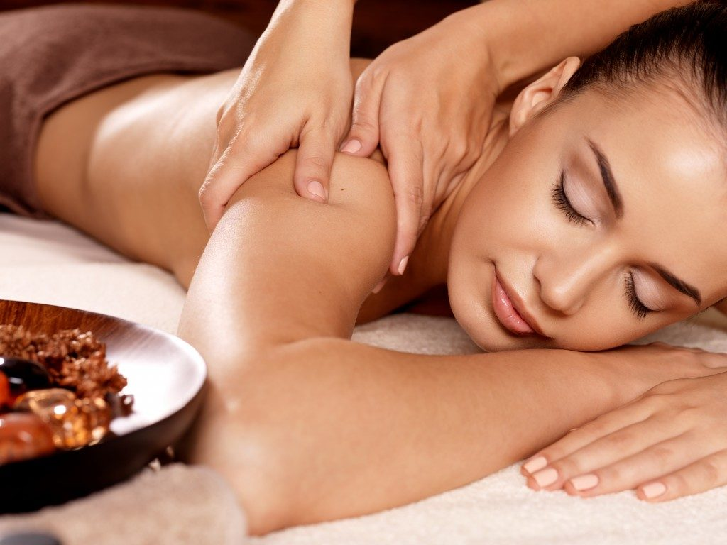 woman enjoying relaxing massage at the spa