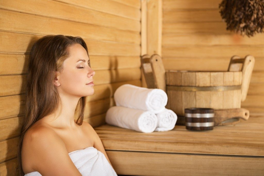 woman enjoying sauna