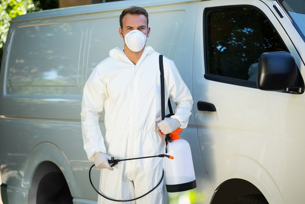 Pest control man next to a van