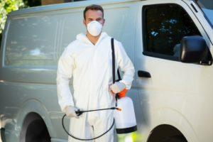 Pest control man next to a van