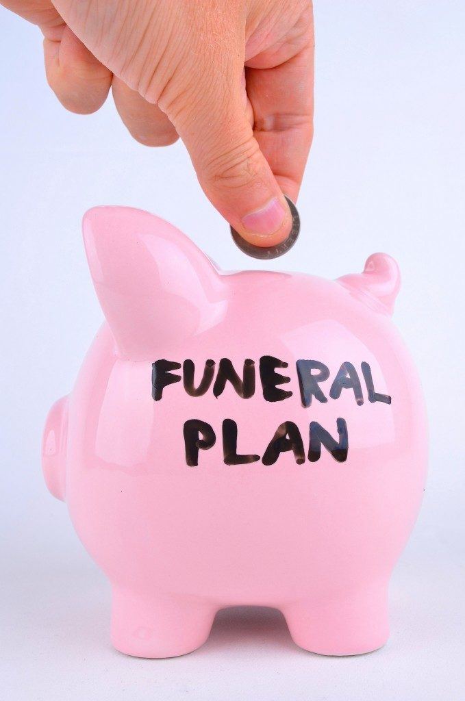 Saving For A Funeral in a pink Piggy bank