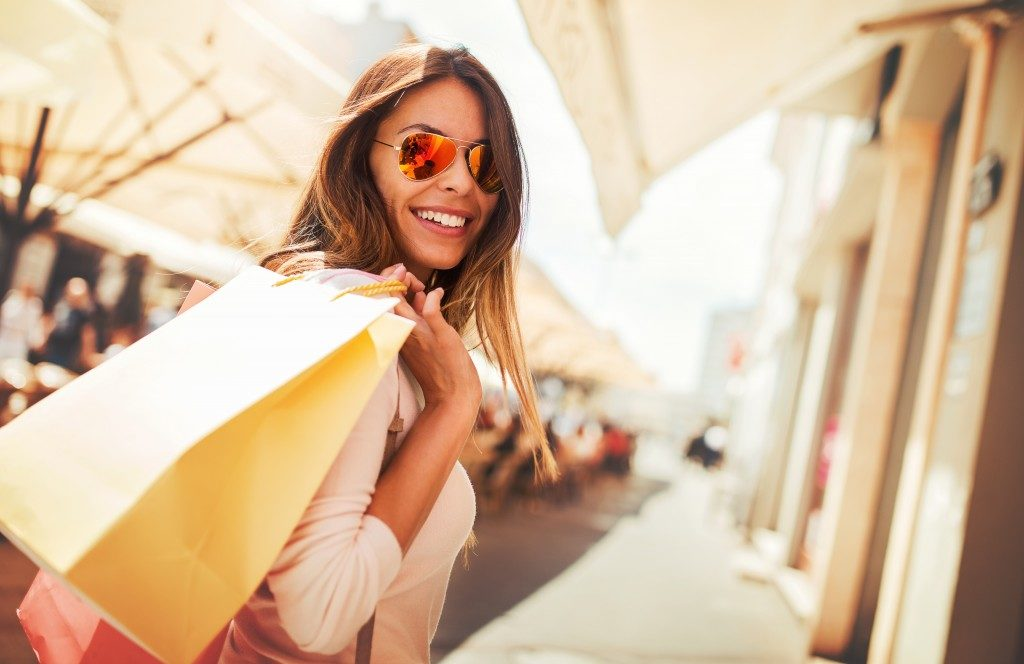 Woman shopping and holding shopping bags