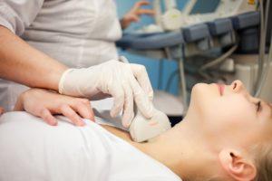 woman having neck check up