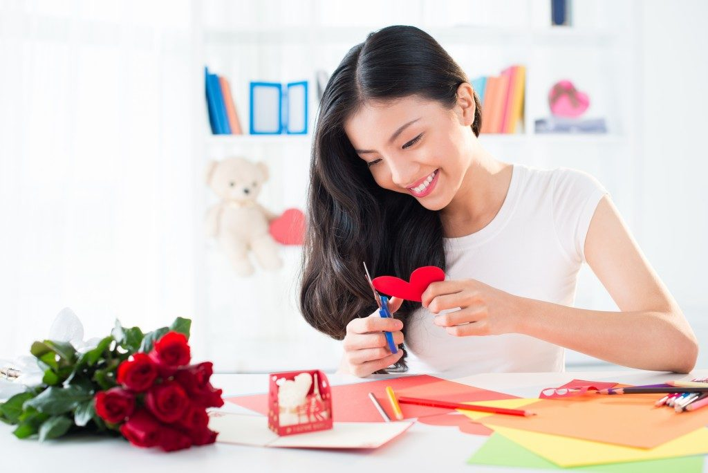 woman making arts and crafts