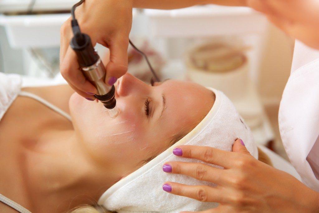 Microneedle meso therapy, treatment woman at the beautician spa salon