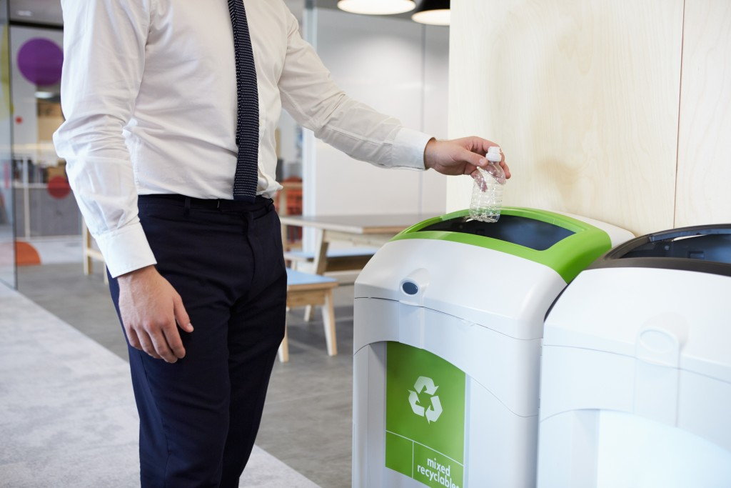 throwing plastic bottle at the recycle bin