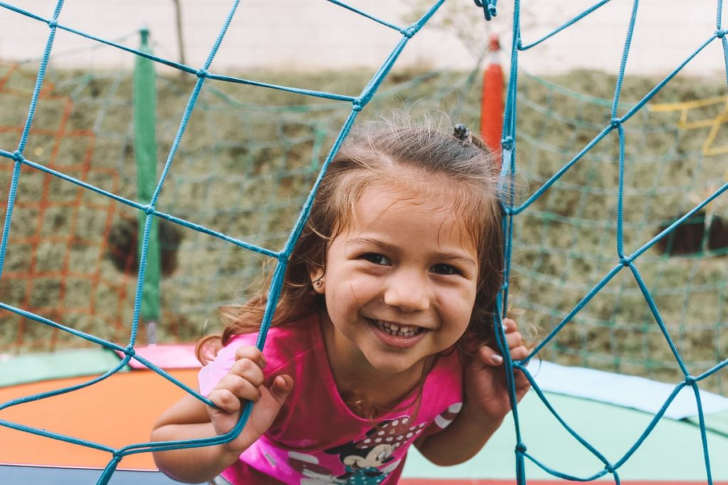 Smiling kid in a playguard