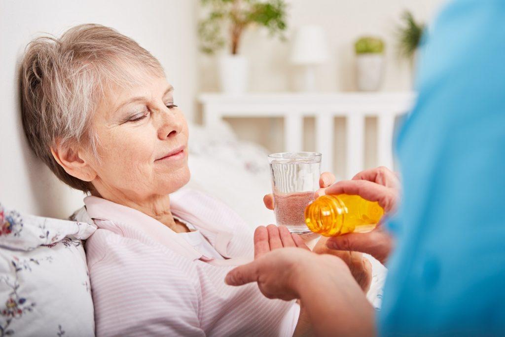 Elder woman taking her meds