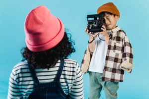kids playing with a camera