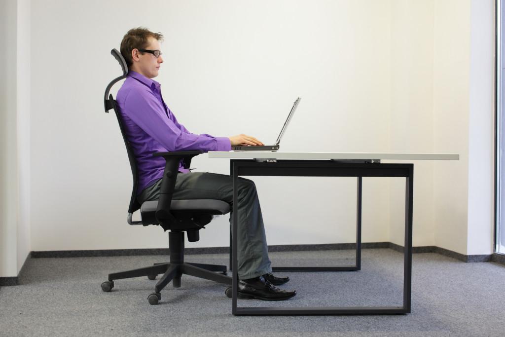 man in ergonomic chair